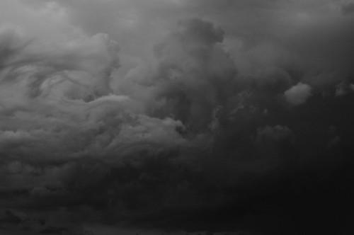 Bondi beach dark storm clouds black and white